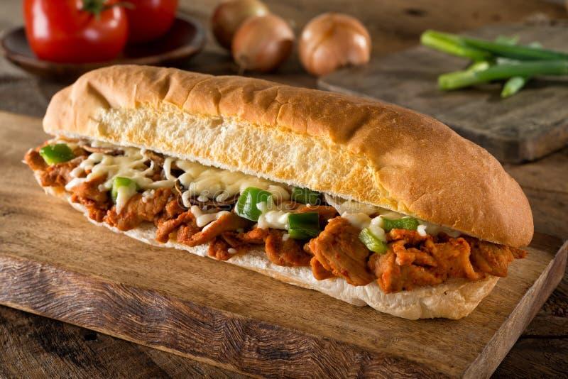 Kryddig smörgås för grillfestgrisköttubåt royaltyfria bilder