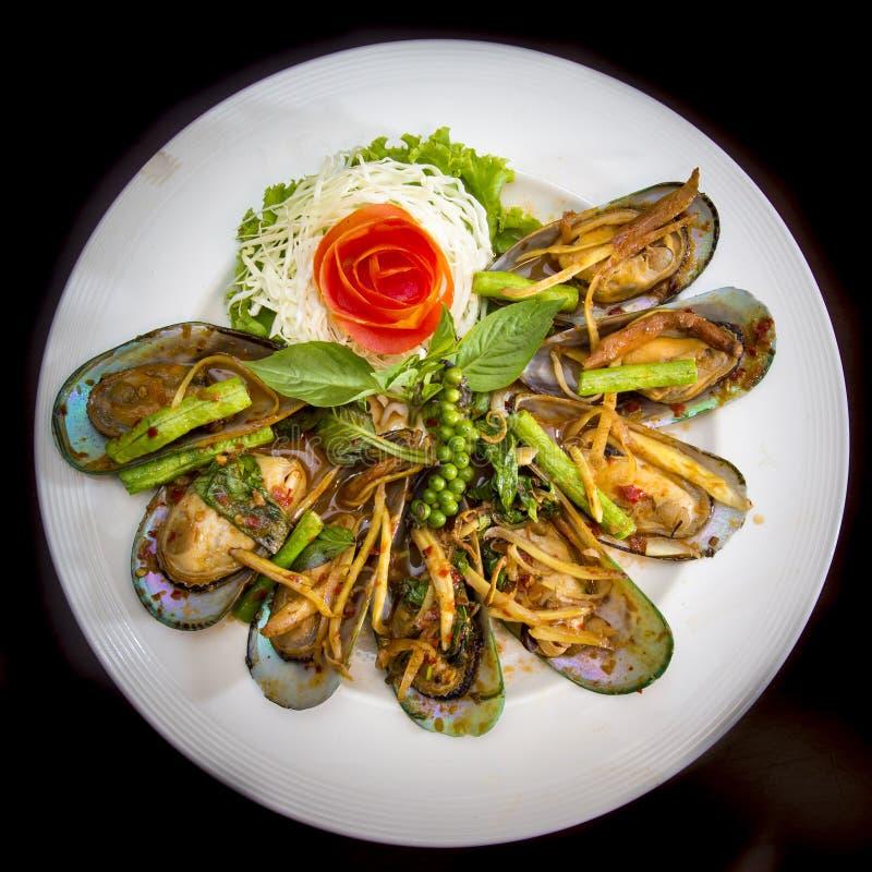 Kryddiga Fried Mussel royaltyfri fotografi