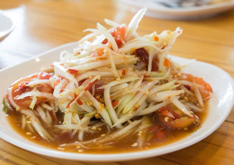 Kryddigt läckert för grön kokkonst för papayasallad thailändsk: Thailändsk ` för `-SOMEN TAM talar arkivfoton