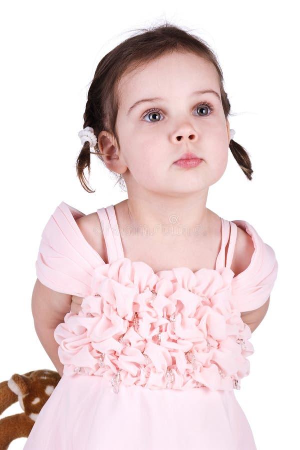 kryje dziewczyny jej mała zabawka zdjęcie royalty free