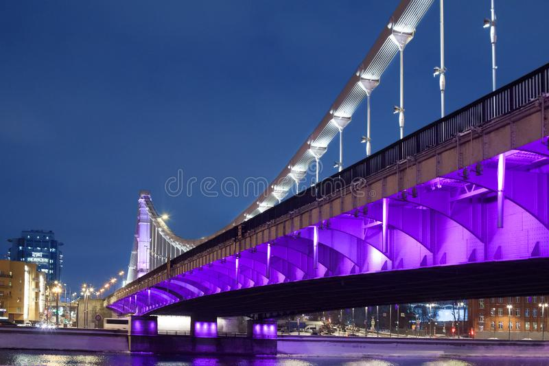 Krymsky Bridge or Crimean bridge in Moscow, Russia night view with purple illumination stock image