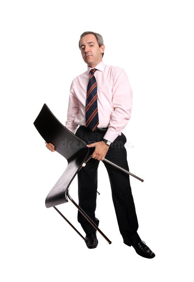 krzesło gospodarstwa biznesmena obraz stock