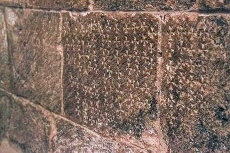 Krzyże ryli w kamienne ściany kościół Święty Sepulcher, zaznacza miejsce Jesus krzyżowanie obrazy stock