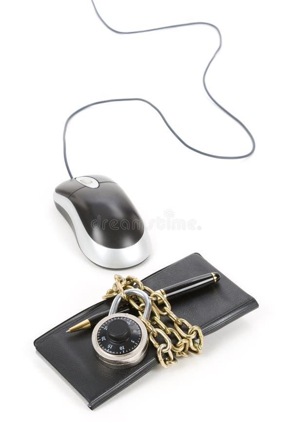książeczki czekowej komputeru mysz fotografia stock
