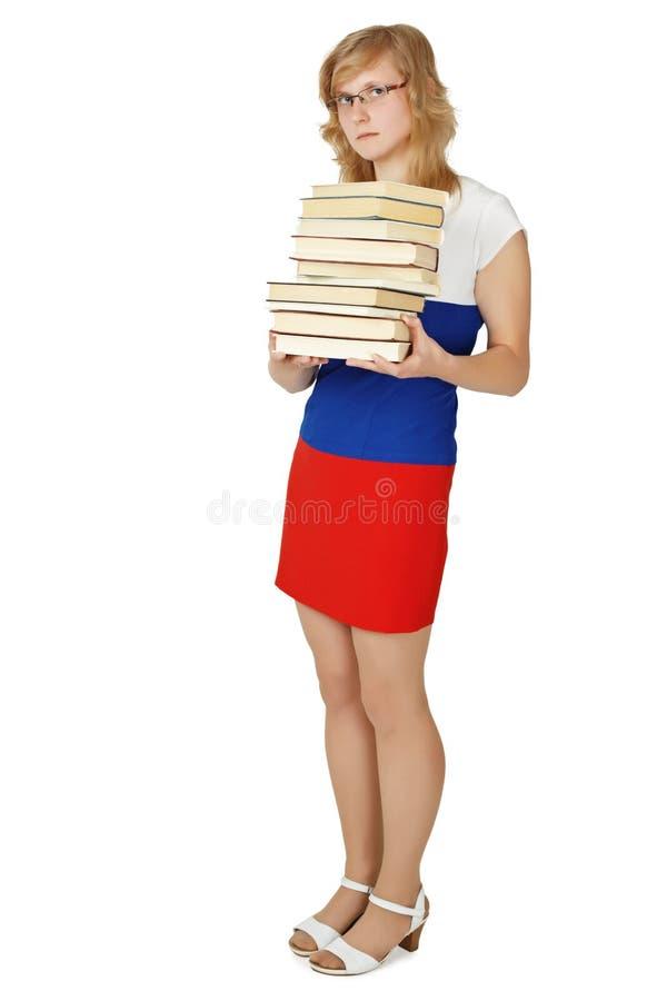 książki wypiętrzają studenckiej kobiety zdjęcie stock