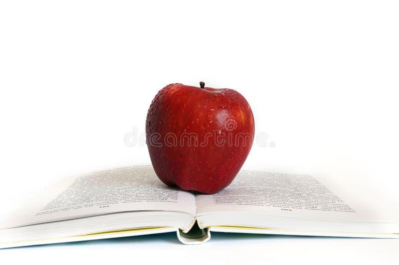 książkowa jabłko czerwień zdjęcia royalty free