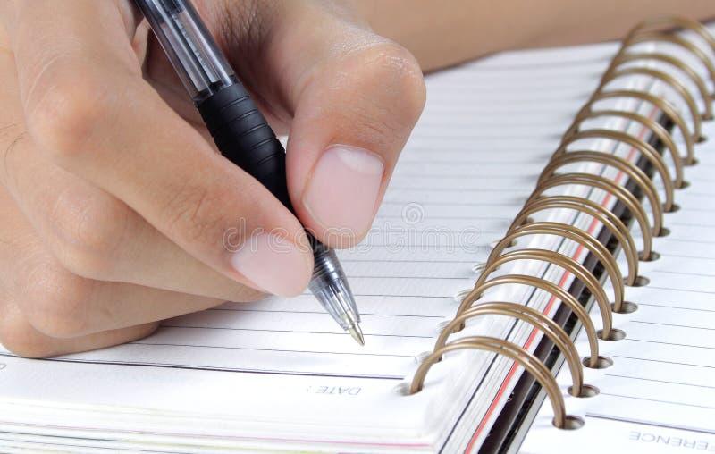 książkowej ręki writing zdjęcia stock
