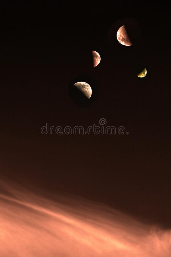 Księżyc ćwiartki na orangey chmurach obraz royalty free