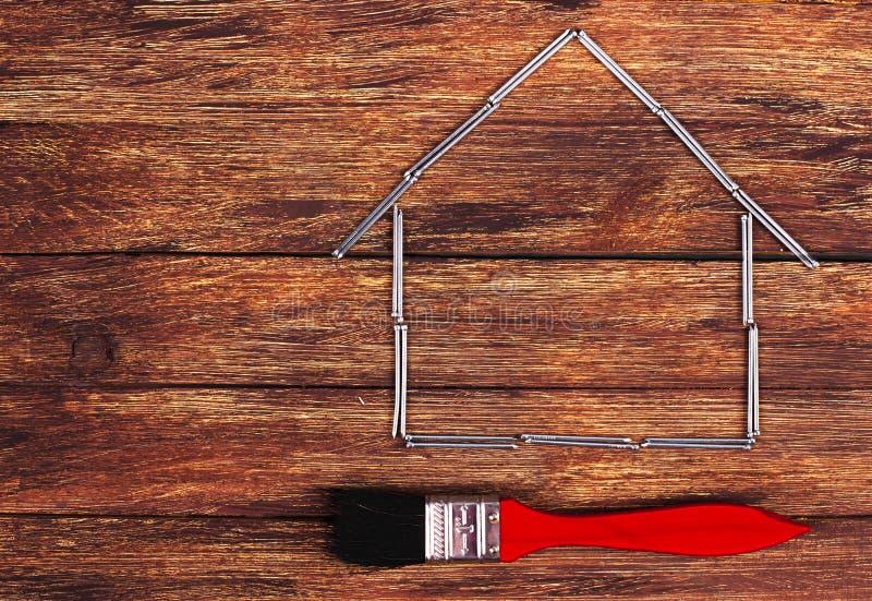 Kształt domowy budynek muśnięcie i - Akcyjny wizerunek obraz stock