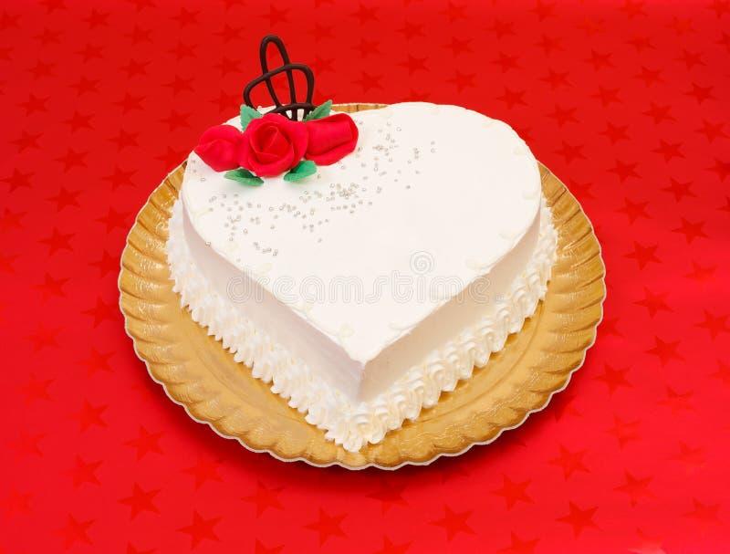 Kształta biały kierowy tort zdjęcie stock