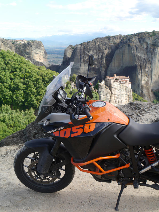 KTM 1050 Adventure at Meteora, Northern Greece. Monastery and mountains in the background stock images
