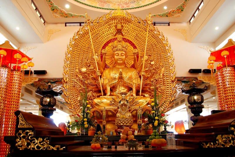 Kuala Lumpur: Chinese Temple Buddha. An immense and impressive seated gold Buddha is the centerpiece of the Fa Jie Guan Yin Sheng Chinese Temple in Kuala Lumpur stock photography