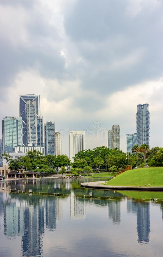 Kuala Lumpur city skyline, Malaysia. Kuala Lumpur, Malaysia - Mart 11, 2019: Skyscrapers are reflected in the water in the pond of Kuala Lumpur City Centre `KLCC royalty free stock images