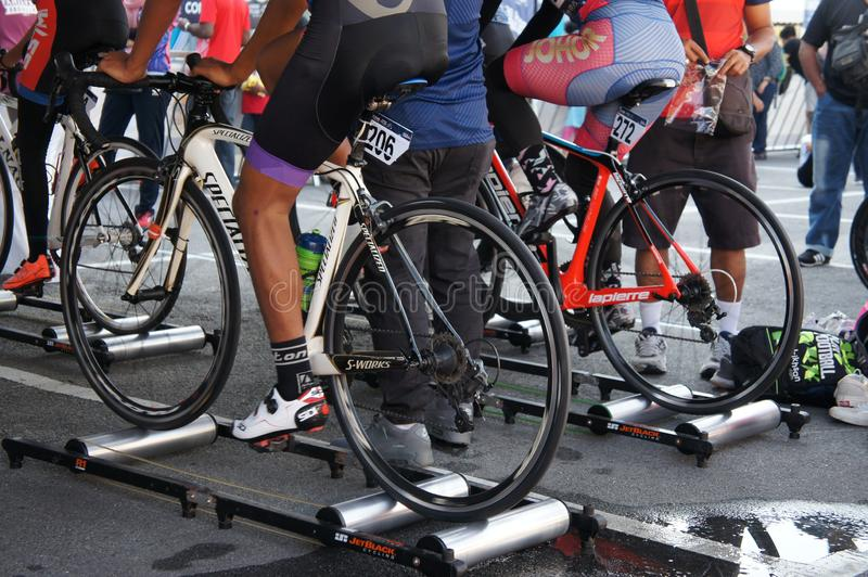 Bicycle riders are using the cycling roller trainer before the race begins. KUALA LUMPUR, MALAYSIA -APRIL 18, 2015: Bicycle riders are using the cycling roller royalty free stock photography