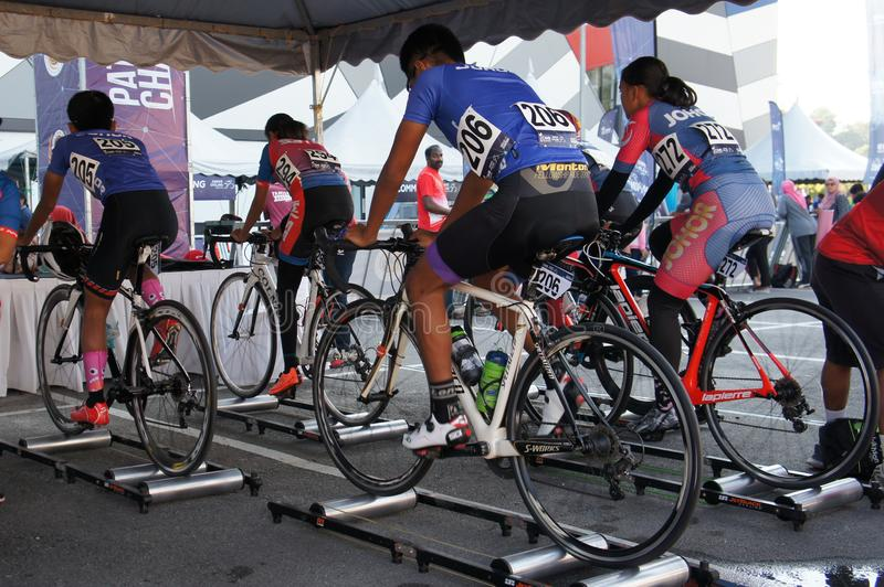 Bicycle riders are using the cycling roller trainer before the race begins. KUALA LUMPUR, MALAYSIA -APRIL 18, 2015: Bicycle riders are using the cycling roller stock photo