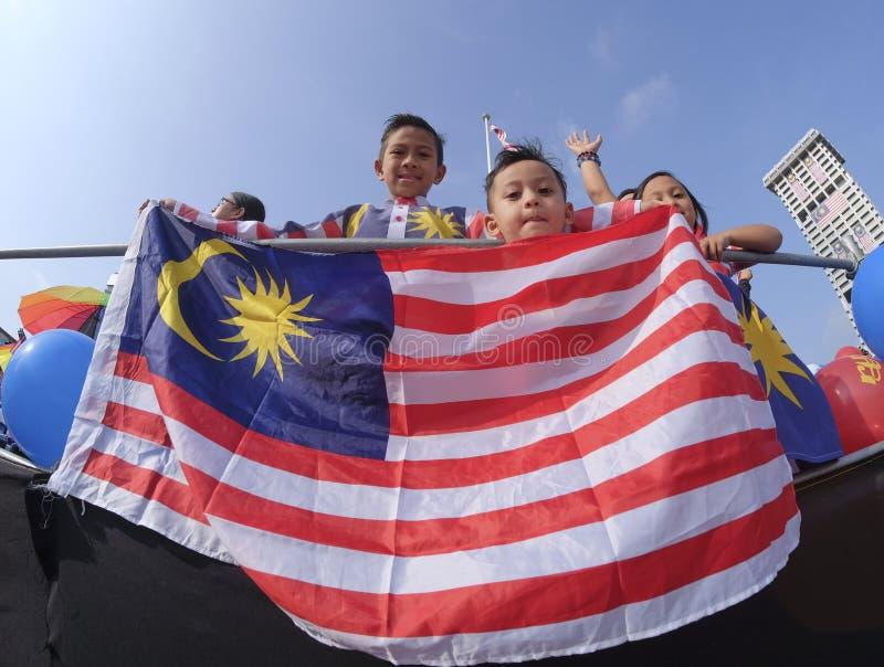 Malaysia Flag, Jalur Gemilang. KUALA LUMPUR, MALAYSIA - AUGUST 31, 2016 : Kids waving Malaysia flag also known as Jalur Gemilang during Independence Day stock photo