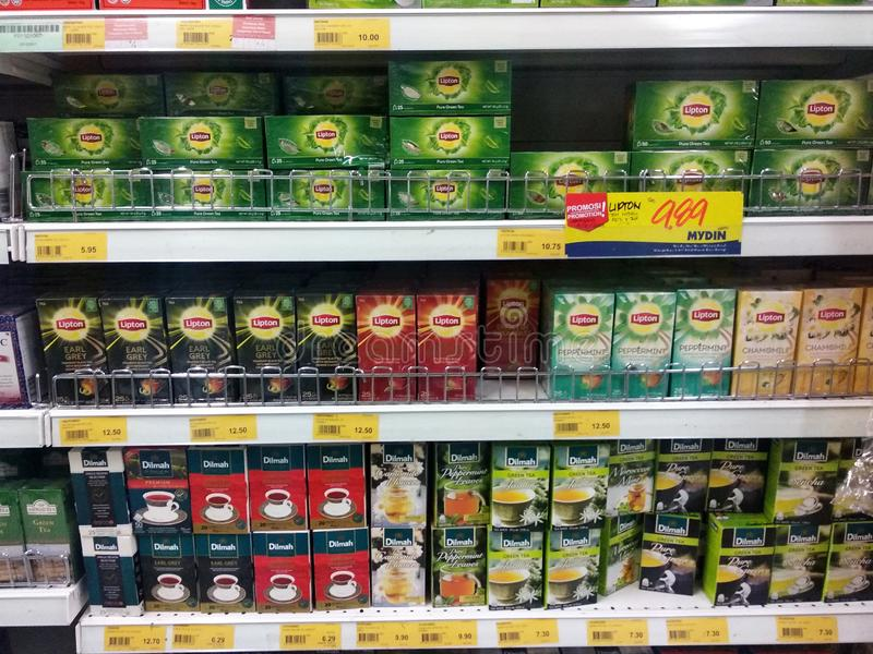 Tea powder is sold in commercial packages and displayed on supermarket shelves for sale. KUALA LUMPUR, MALAYSIA -AUGUST 16, 2019: Tea powder is sold in royalty free stock photography