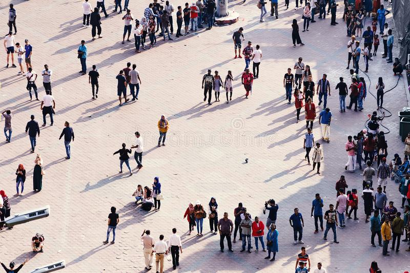 City square with daily life in big town - people crowd who spend their free time, interact with each other. stock photography