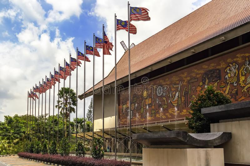 National Museum of Malaysia Muzium Negara and the square next to it with a fountain and national flags against a blue sky stock photo