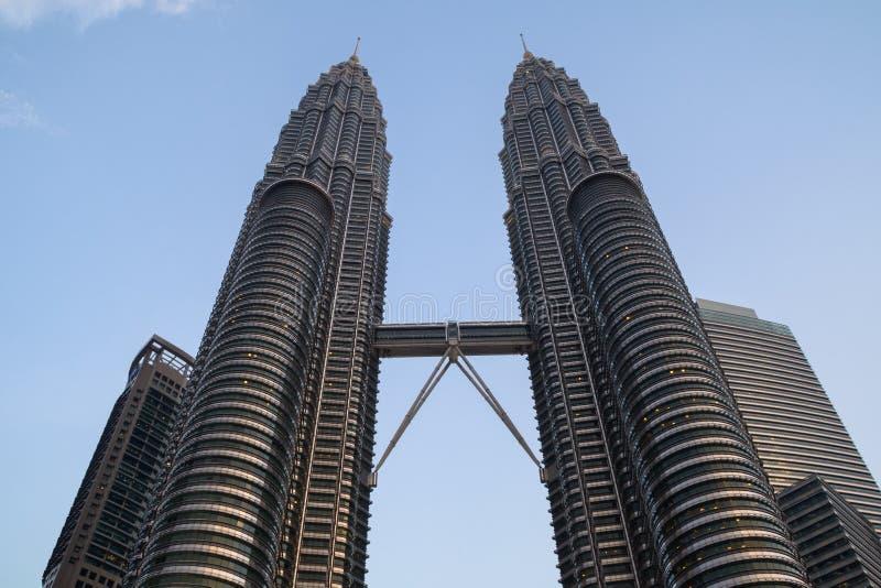 Twin towers Petronas and sky bridge at Mayl 18, 2013, Kuala Lumpur, Malaysia. KUALA-LUMPUR, MALAYSIA - 2015 febrary 16: Twin towers Petronas and sky bridge at royalty free stock image
