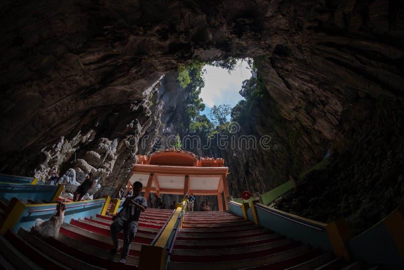 Kuala Lumpur, Malaysia - February 24, 2019: Batu caves looking up from the main cave. royalty free stock image
