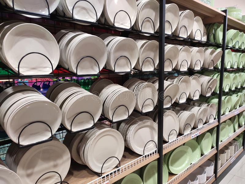 Dishes and bowls are sold on shelves in a supermarket. royalty free stock images