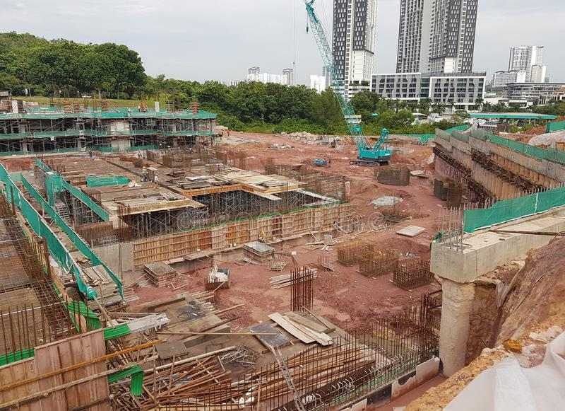 Building substructure and super-structure under construction using the open cut method. KUALA LUMPUR, MALAYSIA -JULY 04, 2018: Building substructure and super royalty free stock image