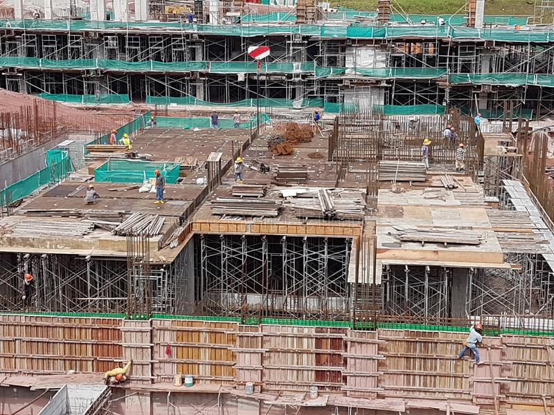 Building substructure and super-structure under construction using the open cut method. KUALA LUMPUR, MALAYSIA -JULY 04, 2018: Building substructure and super royalty free stock images