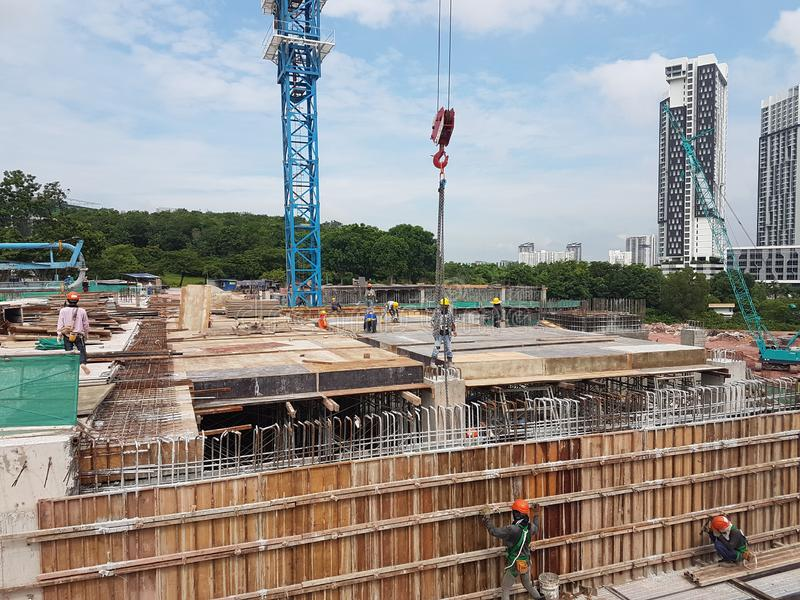 Building substructure and super-structure under construction using the open cut method. KUALA LUMPUR, MALAYSIA -JULY 04, 2018: Building substructure and super stock image