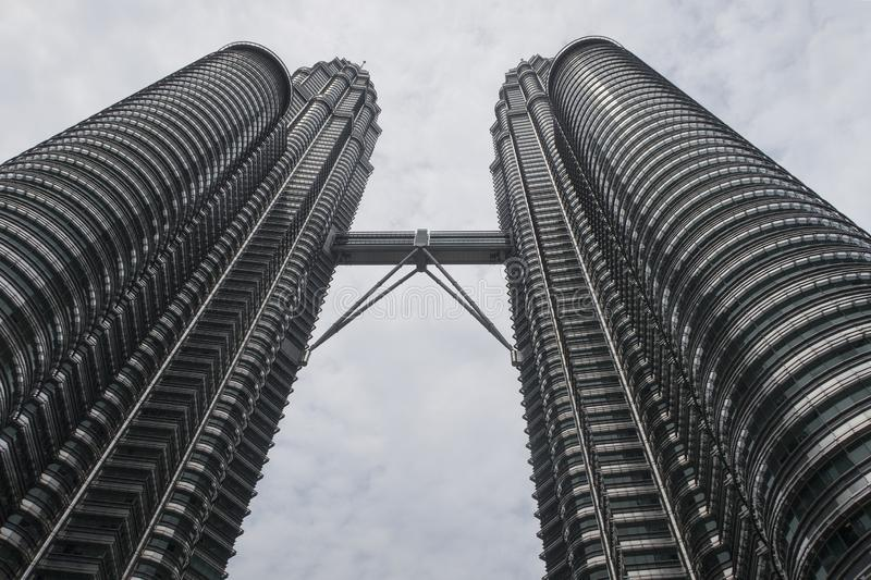 Kuala Lumpur, Malaysia - July 21, 2018; Petronas twin towers seen from ground level, a famous landmark and shopping mall in the. Capital of Malaysia stock images