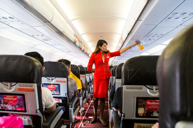 KUALA LUMPUR, Malaysia, June 8, 2017: Airasia hostess demonstrate safety procedures to passengers prior to flight take off royalty free stock photos