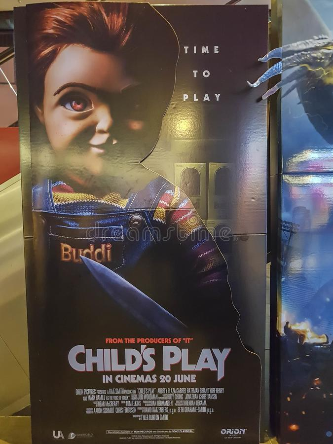 Child`s Play movie poster, is remake of 1988 film about a high-tech doll called Chucky. KUALA LUMPUR, MALAYSIA - JUNE 9, 2019: Child`s Play movie poster, is stock image