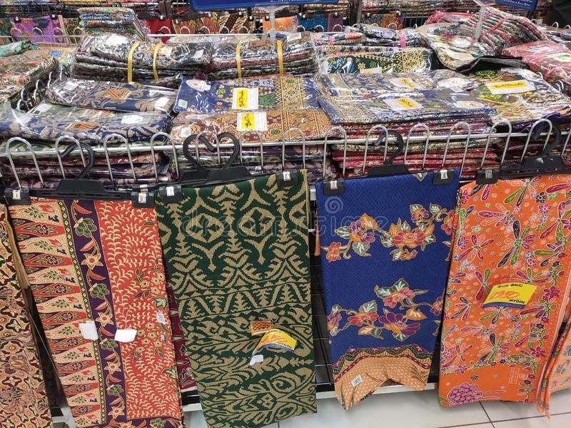 Malaysian batik cloth for woman displayed for sale inside the supermarket. KUALA LUMPUR, MALAYSIA -JUNE 02, 2019: Malaysian batik cloth for woman displayed for royalty free stock photo