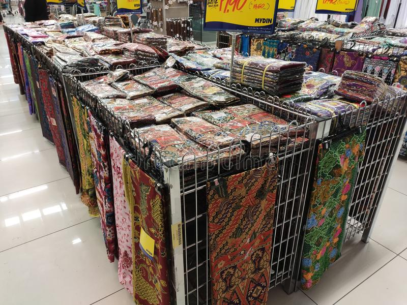 Malaysian batik cloth for woman displayed for sale inside the supermarket. KUALA LUMPUR, MALAYSIA -JUNE 02, 2019: Malaysian batik cloth for woman displayed for stock photography