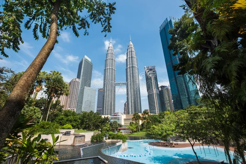 Kuala Lumpur, Malaysia – MARCH 13, 2019: Famous Petronas Twin Towers captured from KLCC Park an urban park in City Centre in. Kuala Lumpur, Malaysia stock image