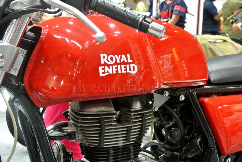 ROYAL ENFIELD motorcycle brand and logos at the motorcycle body. KUALA LUMPUR, MALAYSIA -MARCH 31, 2018: ROYAL ENFIELD motorcycle brand and logos at the stock photos
