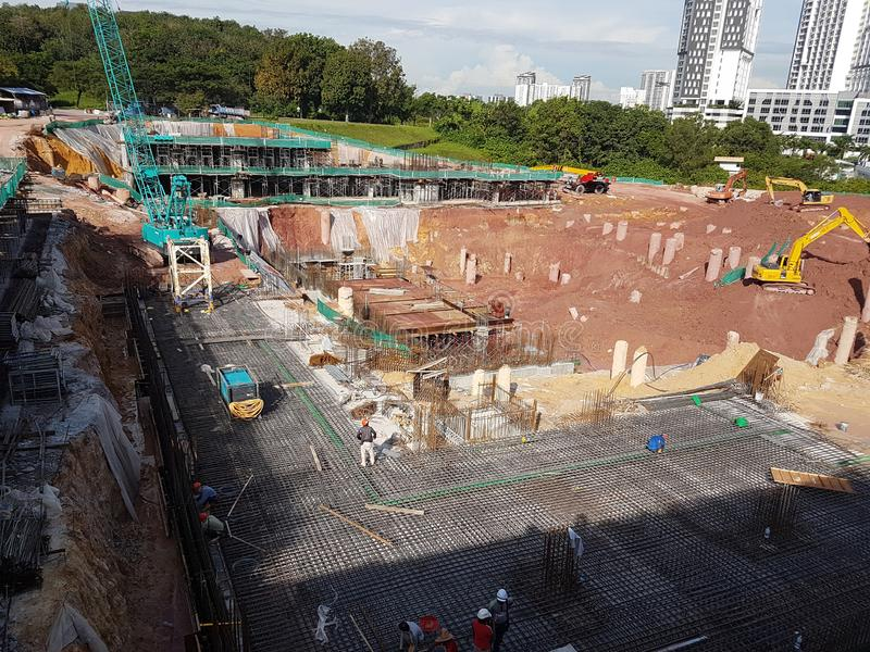 Building substructure and super-structure under construction using the open-cut method. KUALA LUMPUR, MALAYSIA -MAY 25, 2017: Building substructure and super stock images