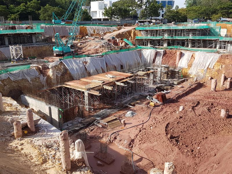 Building substructure and super-structure under construction using the open-cut method. KUALA LUMPUR, MALAYSIA -MAY 25, 2017: Building substructure and super royalty free stock photo