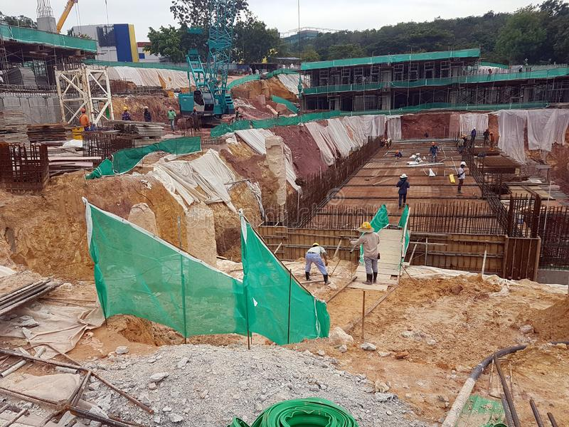 Building substructure and super-structure under construction using the open-cut method. KUALA LUMPUR, MALAYSIA -MAY 25, 2017: Building substructure and super stock photos