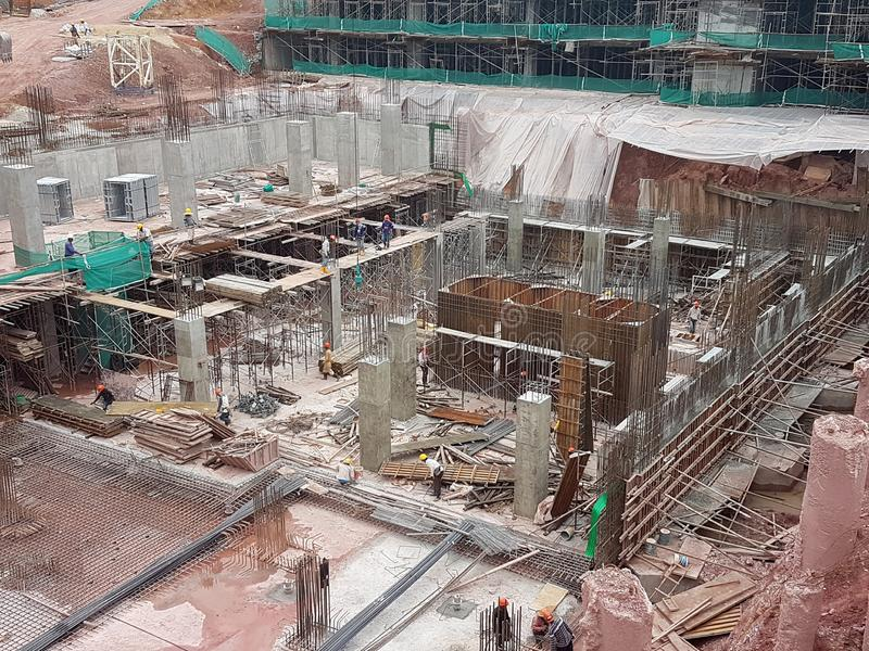 Building substructure and super-structure under construction using the open-cut method. KUALA LUMPUR, MALAYSIA -MAY 25, 2017: Building substructure and super royalty free stock photos