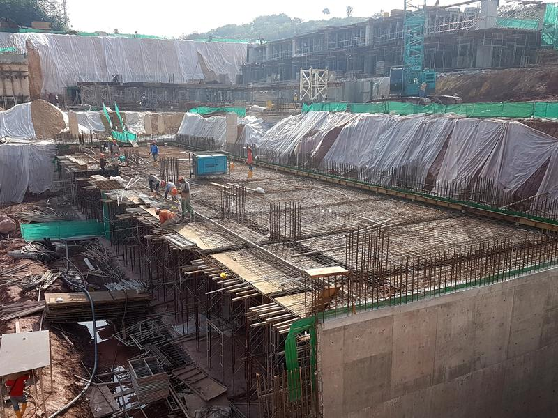 Building substructure and super-structure under construction using the open-cut method. KUALA LUMPUR, MALAYSIA -MAY 25, 2017: Building substructure and super royalty free stock images