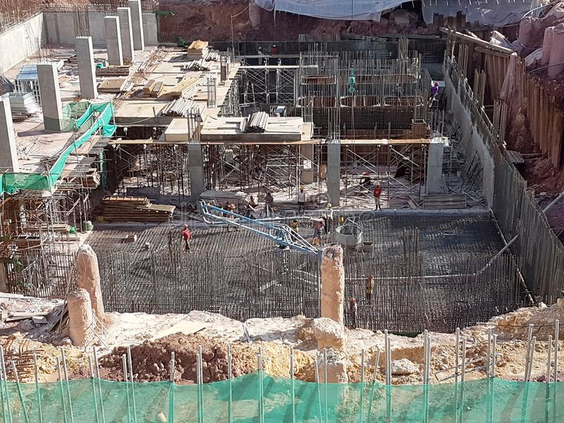 Building substructure and super-structure under construction using the open-cut method. KUALA LUMPUR, MALAYSIA -MAY 25, 2017: Building substructure and super royalty free stock image