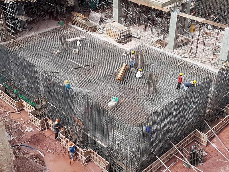 Building substructure and super-structure under construction using the open-cut method. KUALA LUMPUR, MALAYSIA -MAY 25, 2017: Building substructure and super stock image