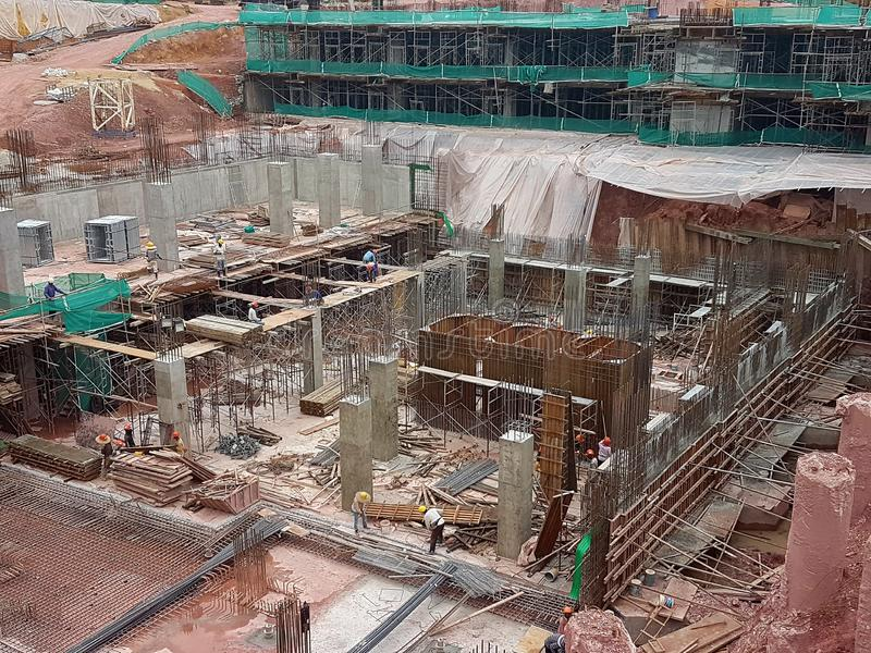 Building substructure and super-structure under construction using the open-cut method. KUALA LUMPUR, MALAYSIA -MAY 25, 2017: Building substructure and super royalty free stock photography