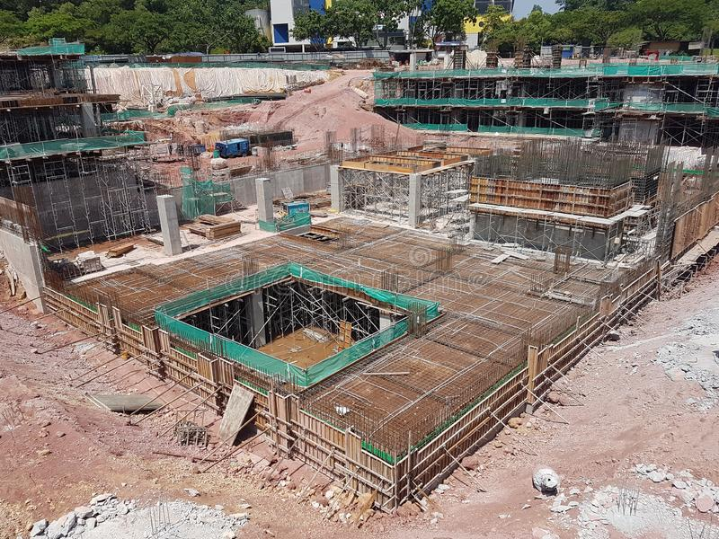 Building substructure and super-structure under construction using the open-cut method. KUALA LUMPUR, MALAYSIA -MAY 25, 2017: Building substructure and super stock photography