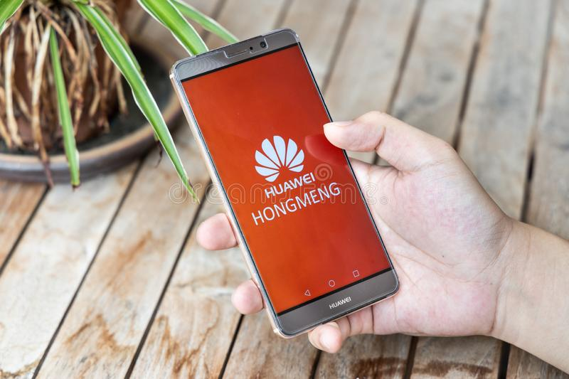 MAY 25, 2019: Person holding Huawei Mate phone with Hongmeng OS symbol. U.S. companies began  to curb sales to Chinese telecom Hua stock photos