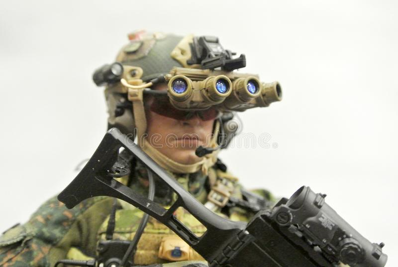 Selected focused of modern army action figure complete with uniform, battle gear and weapon. royalty free stock photography
