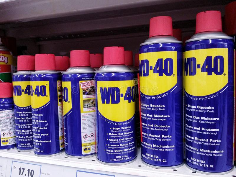 KUALA LUMPUR, MALAYSIA - MAY 20, 2017 : WD-40 product on a supermarket aisle. WD-40 is the trademark name of a penetrating oil and water-displacing spray royalty free stock photos