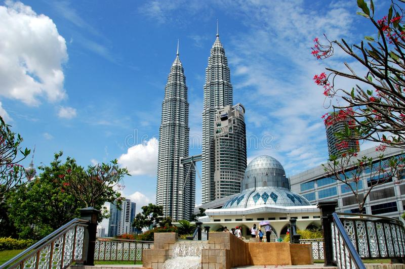 Kuala Lumpur, Malaysia: Mosque & Towers. The Asy-Syrakirin Muslim Mosque with its great dome in KLCC Park and the nearby soaring twin Petronas Towers in Kuala stock photos