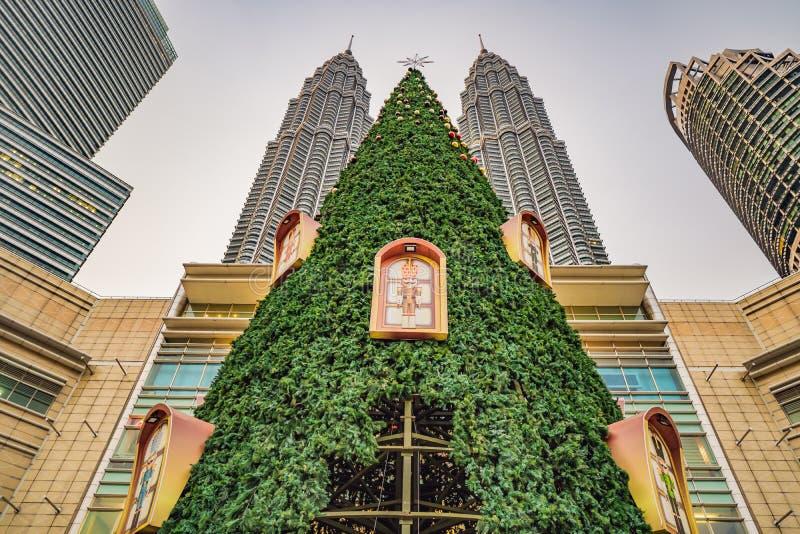 Kuala Lumpur, Malaysia, November 18, 2018: Big Christmas tree and city skyscrappers in the tropics royalty free stock image